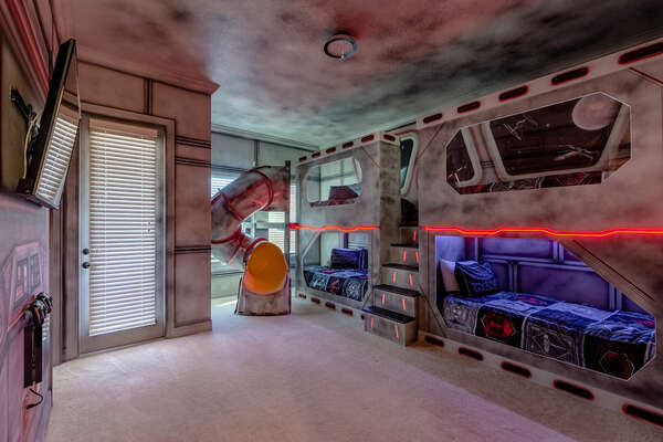There's so much fun waiting in this galaxy-inspired bedroom