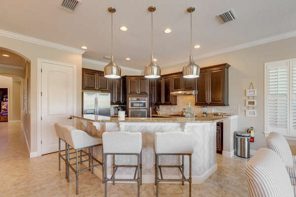Beautiful fully equipped kitchen with barstool seating
