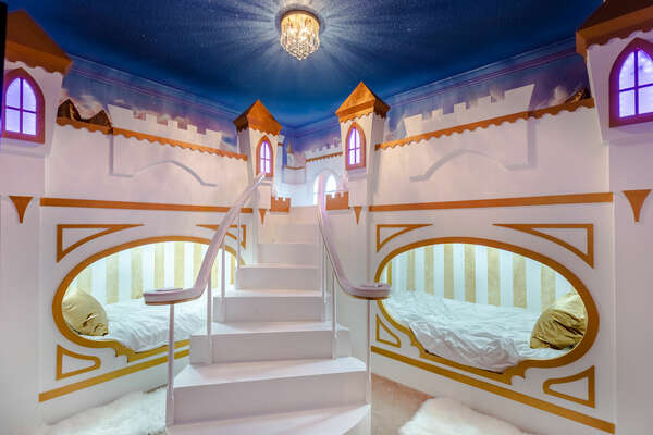 A custom princess kids' bedroom with 2 twin over twin bunk beds