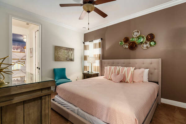A master suite with a king-size bed