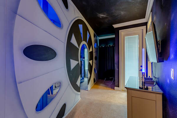 Entering this custom built kids bedroom is like entering a galaxy far, far away