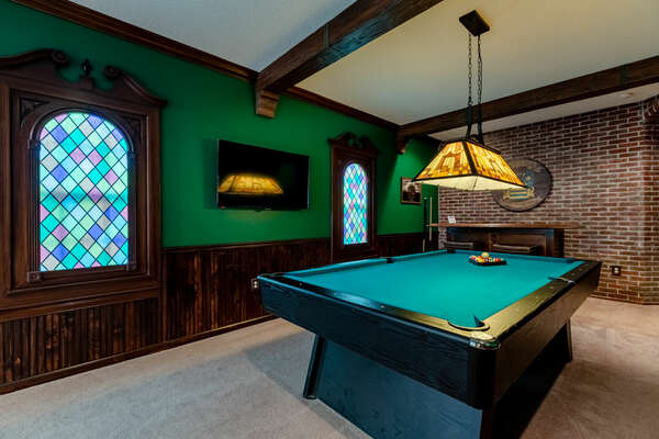 A pool table and 50-inch SMART TV