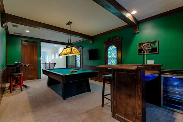 The themed loft area features a mini bar area, pool table, and SMART TV