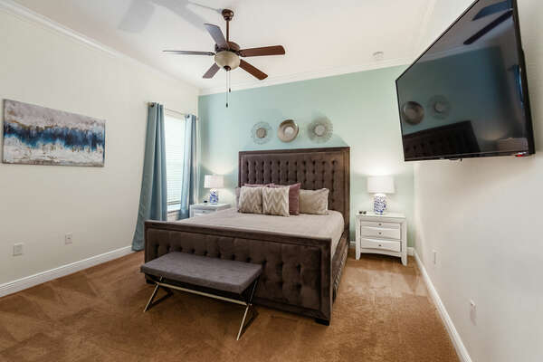 This master suite on the main floor has a King sized bed, 50 inch SMART TV and en suite bathroom