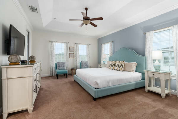 The upstairs Master bedroom features luxury furnishings including a King bed and seating area