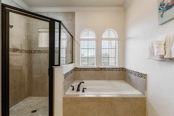 A walk-in shower and tub