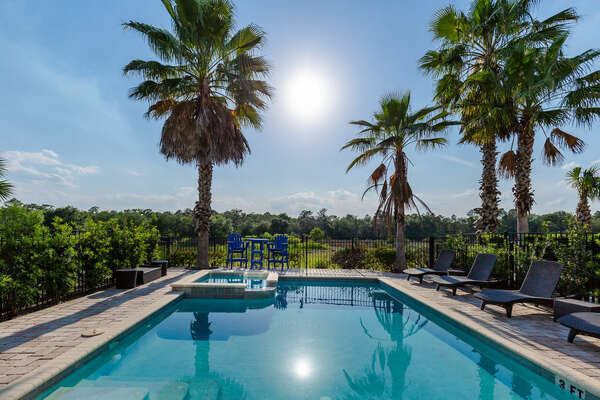 The pool area features a view of the Jack Nicklaus golf course