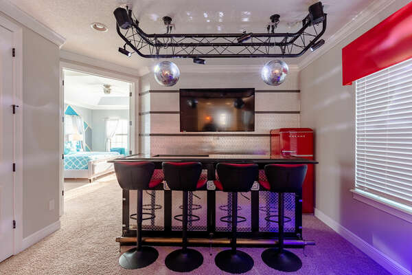 Enjoy a drink or snack at the wet bar and watch your favorite shows or movie on the