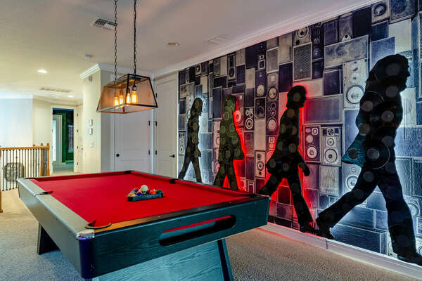 Play a friendly competition of pool with your family and friends