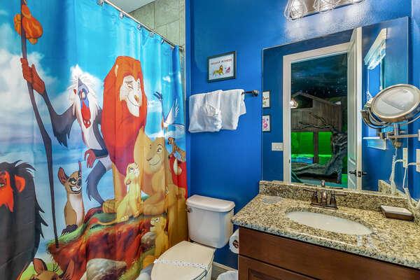 The en-suite bathroom features a shower/tub combination