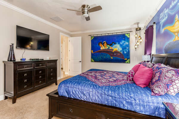 The master suite features a king bed, en-suite bathroom, and a SMART TV