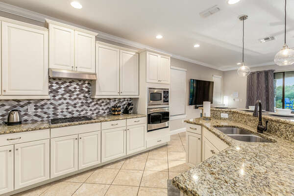 Fully equipped kitchen that features stainless steel appliances