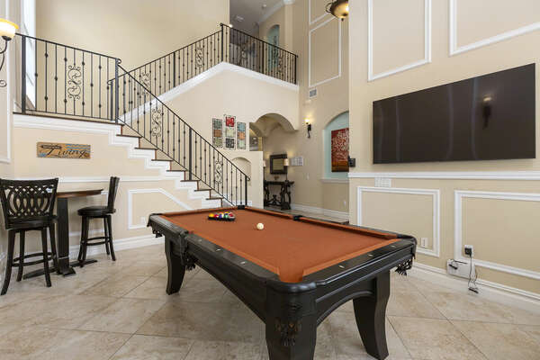 Shoot pool or watch the big game in your own billiard room