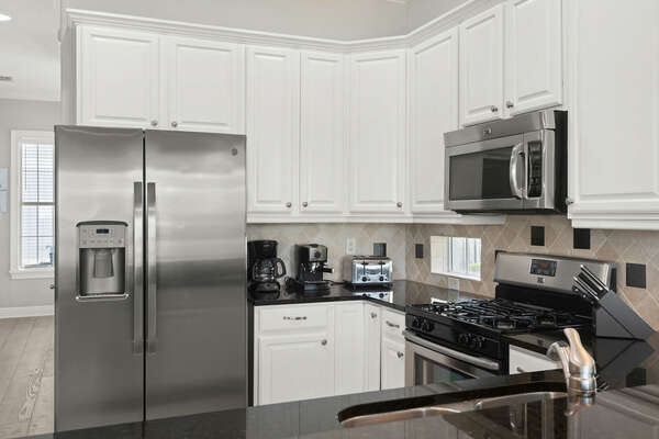 The kitchen features stainless steel appliances