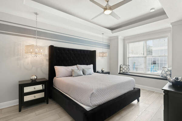 The first master suite on the ground floor features a king size bed and en-suite bathroom