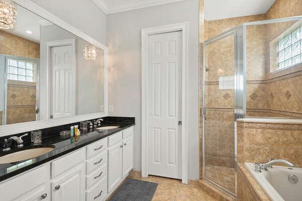 The en-suite bathroom features dual vanity and walk-in shower