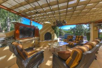 Watch the big screen TV fireside with the lake and Santa Rosa mountains in the background