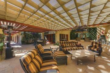 High end outdoor furniture with oversized cozy cushions and 3 propane space heaters