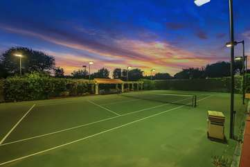 Fully lit tennis court.   *The neighbors tennis courts are connected through a gate and are also available to guests (TWO tennis courts total)
