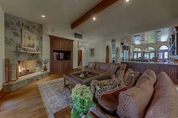 Open floor plan, multiple fireplaces and lots of windows