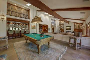 The Pool table/bar area is a favorite spot and great for entertaining