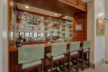 Full size bar with mini fridge and dishwasher.  Our concierge service can provide a bartender for your event and stock the bar with liquor prior to your arrival