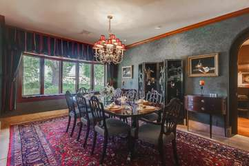 The formal dining room has a view of the garden