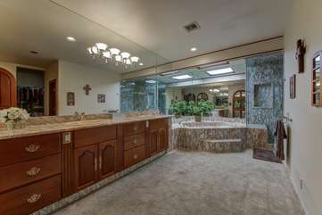 Large Master bathroom has 3 sinks, 2 separate showers and huge tub.  Bathroom 1