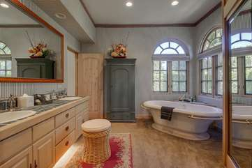 Bathroom 4 has an old fashioned tub and separate shower