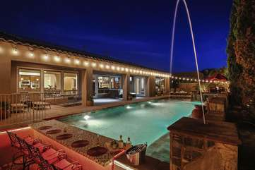 This is an Entertainers Pool with water features and custom swim up/walk up bar unlike any other pool in town