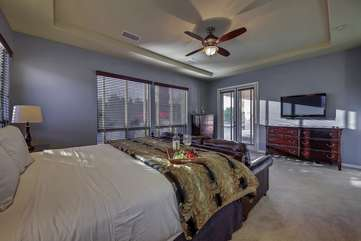 Master bedroom has its own separate access to the pool area and big screen TV