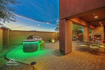 Pavers wrap around the house leading to the backyard BBQ area with other seating areas to escape the pool area
