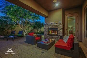 Outdoor living area in back has it's own fiireplace and entrance to the master bedroom