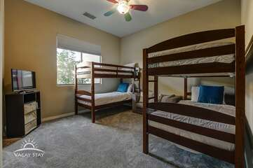 Bedroom 5 has 2 twin bunk beds to sleep 4 plus a fold out chair bed in the middle and TV