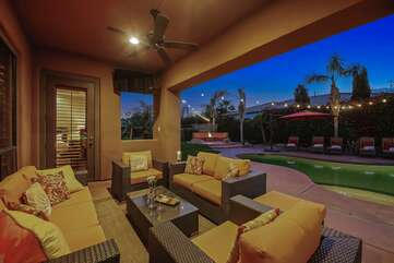 Covered outdoor living area with TV and seating for 7