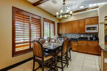 Large formal eat in kitchen area with separate desk for travelers that brought a laptop