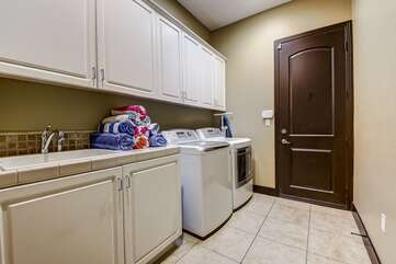 Laundry room has a newer washer and dryer so you can go home with clean clothes if you like