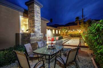 Conveniently located near the Bocce ball court, another patio dinning table for 6.