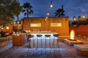 Have after dinner drinks on the built in Barbecue are featuring high top chairs for eight!