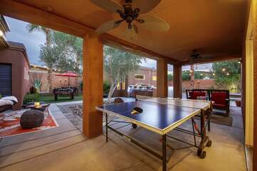 Challenge a friend to a ping pong tournament, stay cool under the outdoor fan.