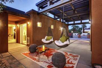 Hang out (literally) on the two trendy swing chairs while you bask in the desert views.