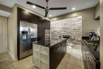 The fully equipped kitchen is just off the dining area and has everything you need to prepare delicious meals during your stay.