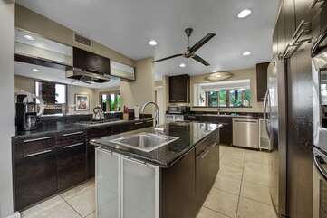 Enjoy the functional island and granite countertops. Our concierge service can stock the fridge with your favorite groceries.