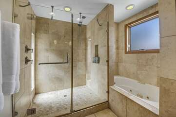 The en-suite master bathroom has dual sinks and a tiled shower.