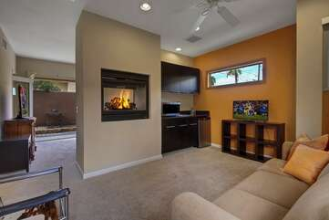 Casita Suite 2 is located in the private, detached casita near the Barbecue. The Casita Suite 2 living room features a couch/Queen sofa sleeper and Smart TV. The double sided gas fireplace visible from both the bedroom or casita living room.