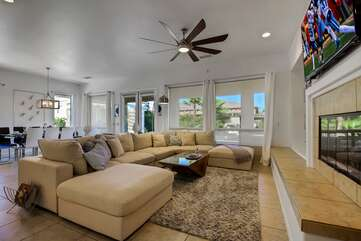 The large windows all around make it easy to watch the pool from the living room