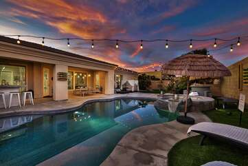 Two bars, 9 lounge chairs and a huge firepit make this backyard THE place to be!