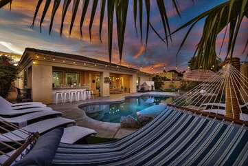 Enjoy your desert vacation and relax in the hammock  over the white sand