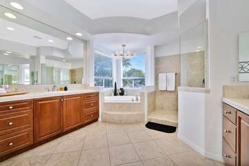 The master bathroom has his & hers sinks , step in shower and huge tub bathroom 1 Full Bath