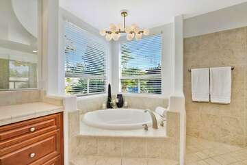 Take a relaxing bath in the huge master tub